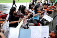 Practising hard under the guidance of street musicians