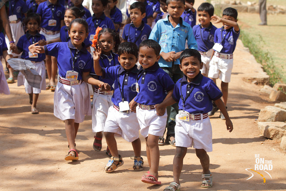 Smiling school kids on a picnic to the heritage site of Hampi, Karnataka, India