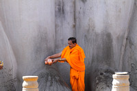 Jain priest washing the feet of Baahubali, Shravanabelagola, Karnataka