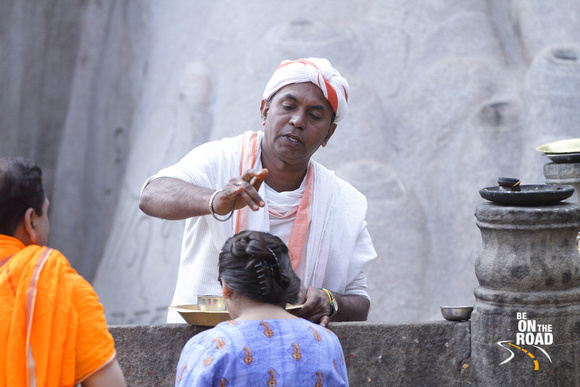 Jain priest giving blessings to devotee at Shravanabelagola, Karnataka