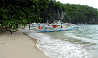 Boats moored on Sabang beach that is decorated with mangroves