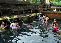 Taking a holy bath at the Pura Tirtha Empul, Bali, Indonesia
