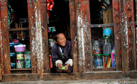Smiling Bhutanese Kid from a shop window in Trongsa