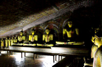 Beautiful Cave Murals and the maze of Buddha statues inside Dambulla Rock Temple, Srilanka