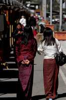 Bhutanese Women enjoy the winter sun during a stroll in Thimphu, Bhutan