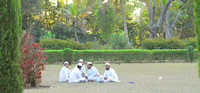 Locals having a chat on the Gumbaz gardens, Srirangapatna
