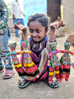 Innocence personified - Girl child and her puppet toys