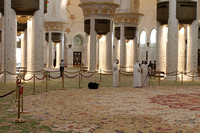 Emirati men photographing inside the Sheikh Zayed Grand Mosque, Abu Dhabi
