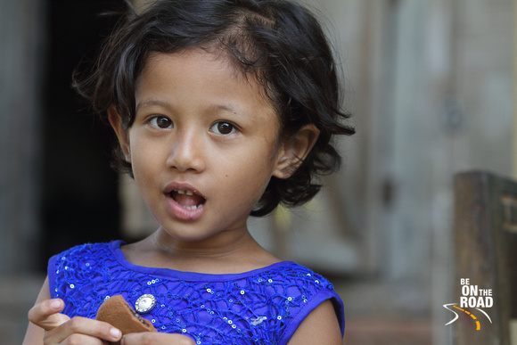 The cookie goobler - Girl from Mishing Tribal Village, Assam, India